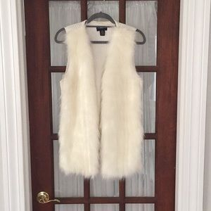 White fur and knit vest